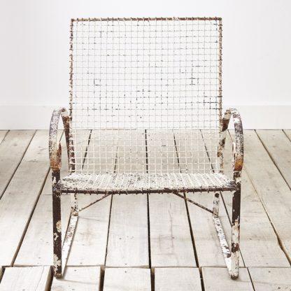 Distressed garden armchair