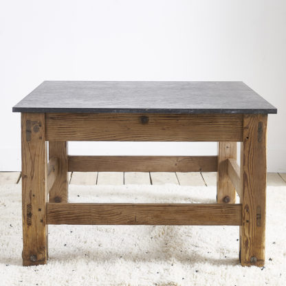 Ancient workshop table with blue stone.