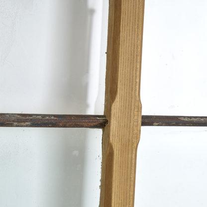 Ancienne porte arrondie en bois patiné