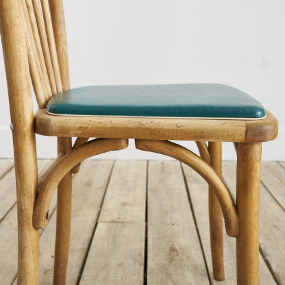 """Ensemble de 4 chaises """" Baumann"""" des années 60."""