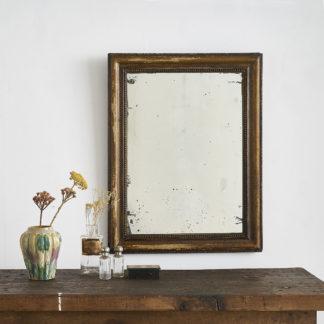 Ancien miroir, encadrement en bois à la patine vieil or